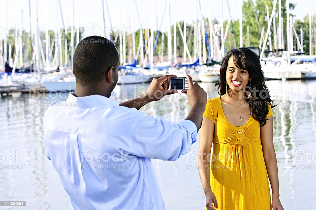 Woman posing for picture near boats royalty-free stock photo