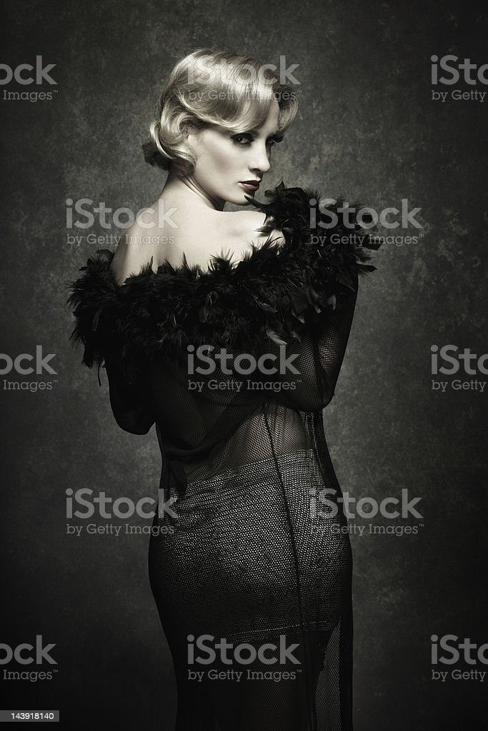 woman posing in feather boa - retro style stock photo