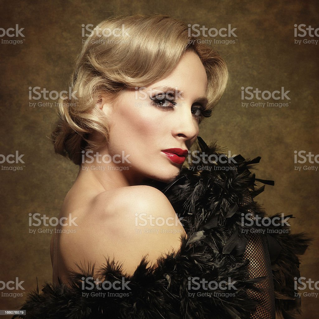 woman posing in feather boa - retro style royalty-free stock photo
