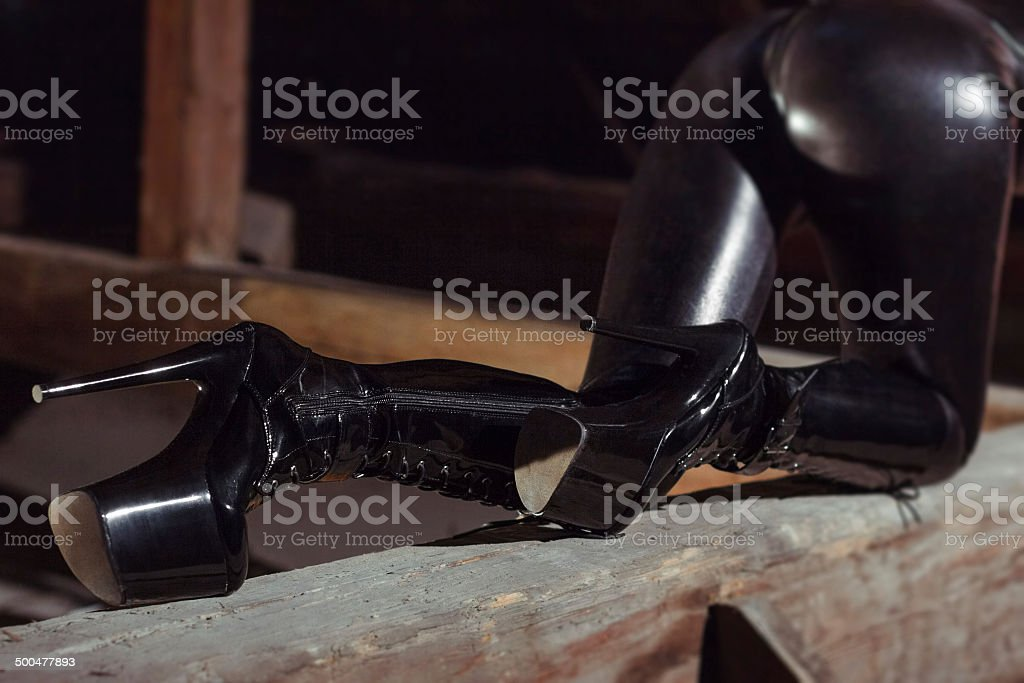 Woman posing in latex boots royalty-free stock photo