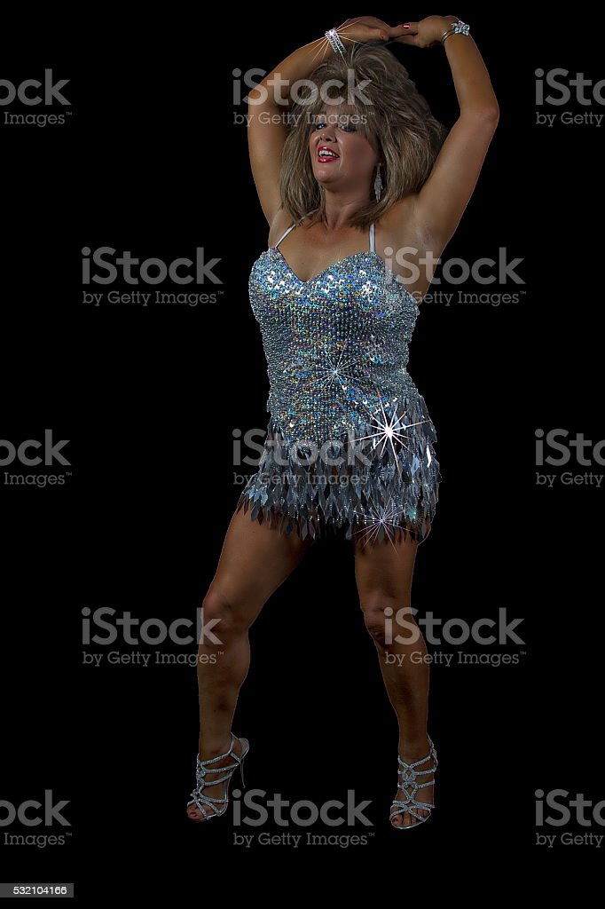 Woman posing in silver dress stock photo
