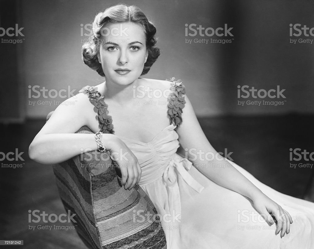Woman posing in studio, smiling (B&W), portrait royalty-free stock photo