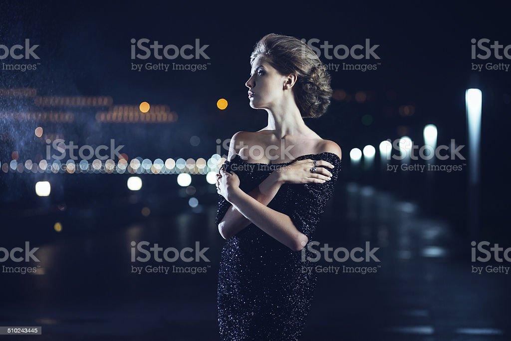 Woman posing in the rain. stock photo