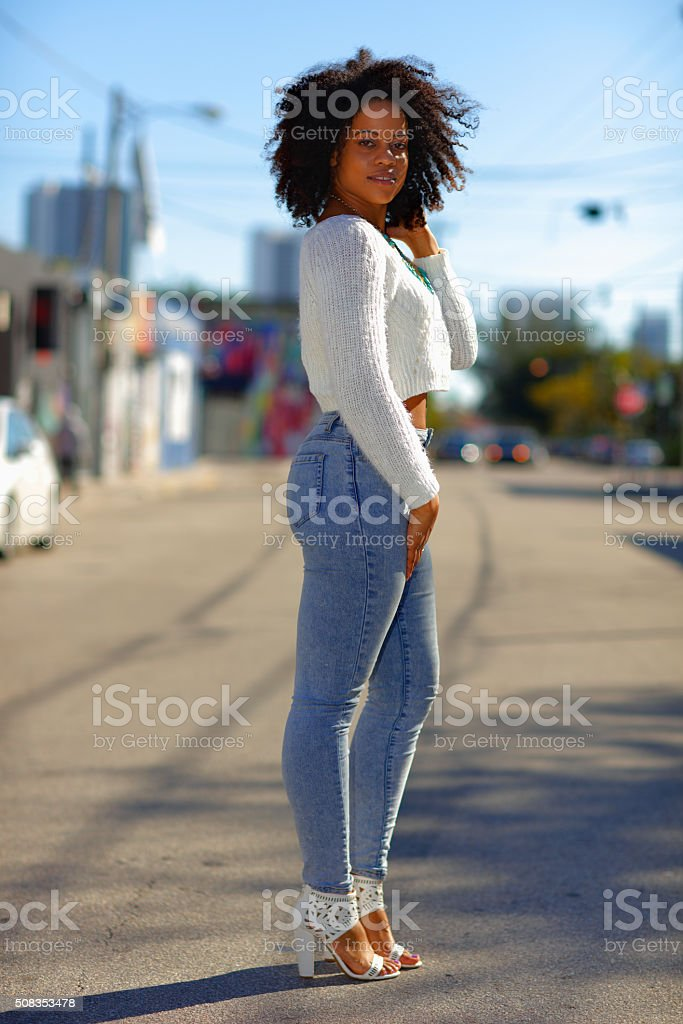 Woman posing in tight jeans stock photo