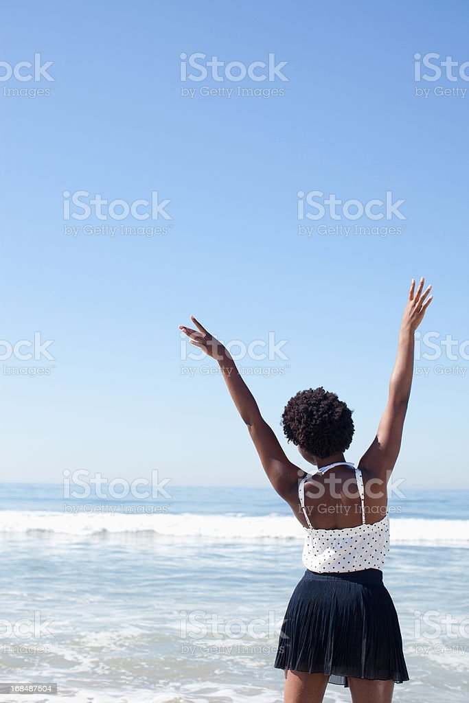 Woman posing in waves on beach royalty-free stock photo