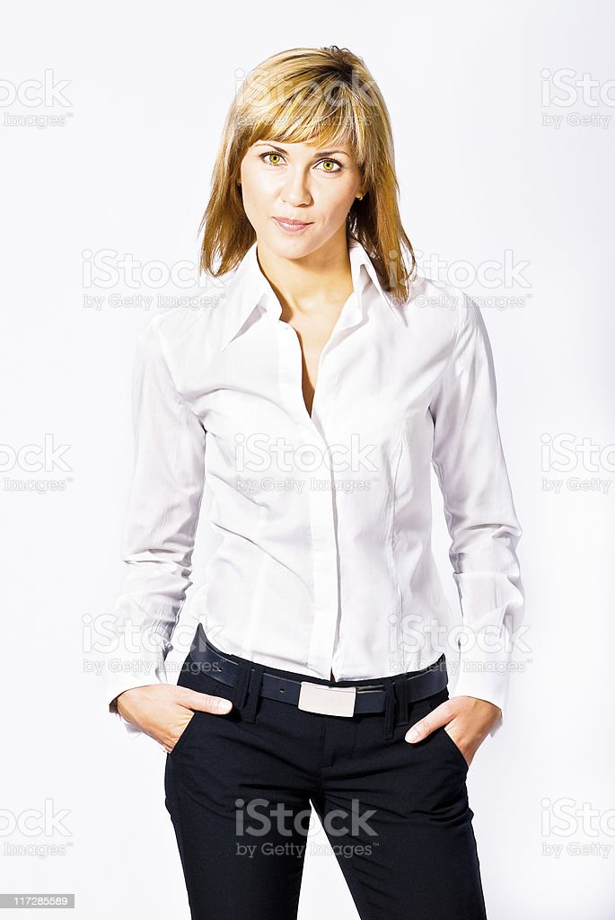 Woman posing in white shirt and black jeans with belt stock photo