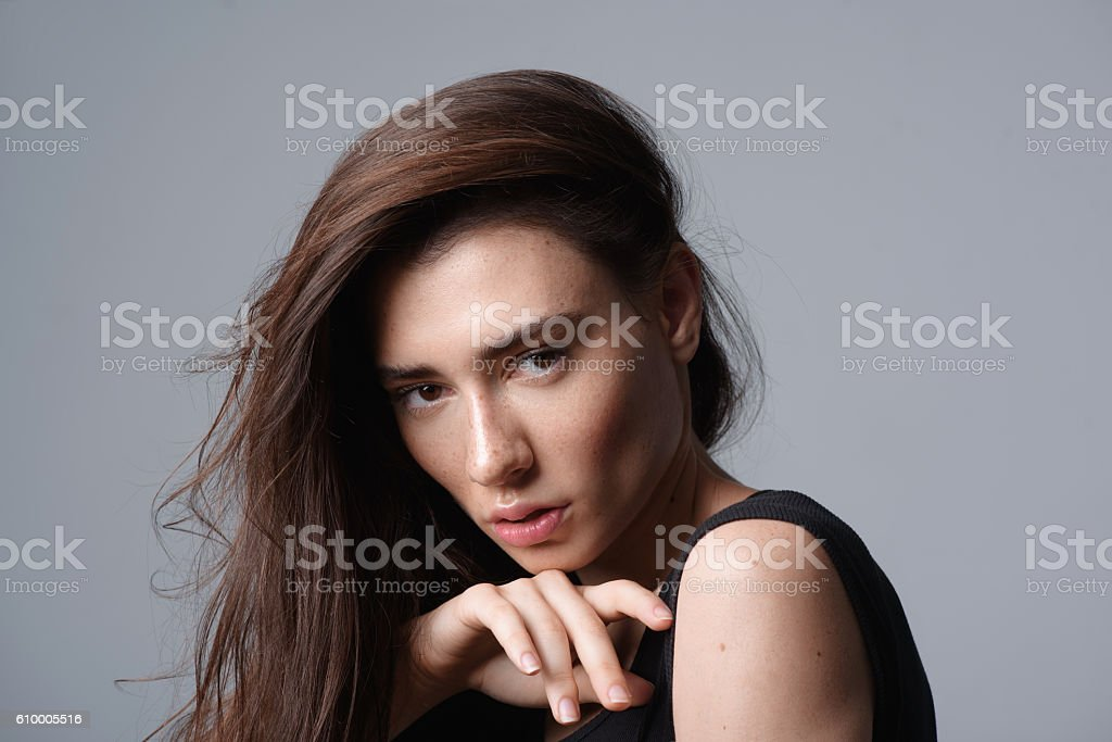 woman posing isolated on light grey background stock photo