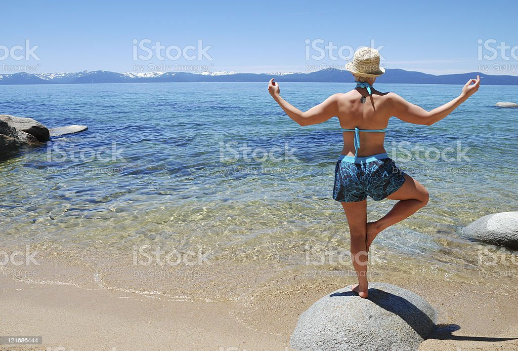 Woman Posing on a Rock royalty-free stock photo