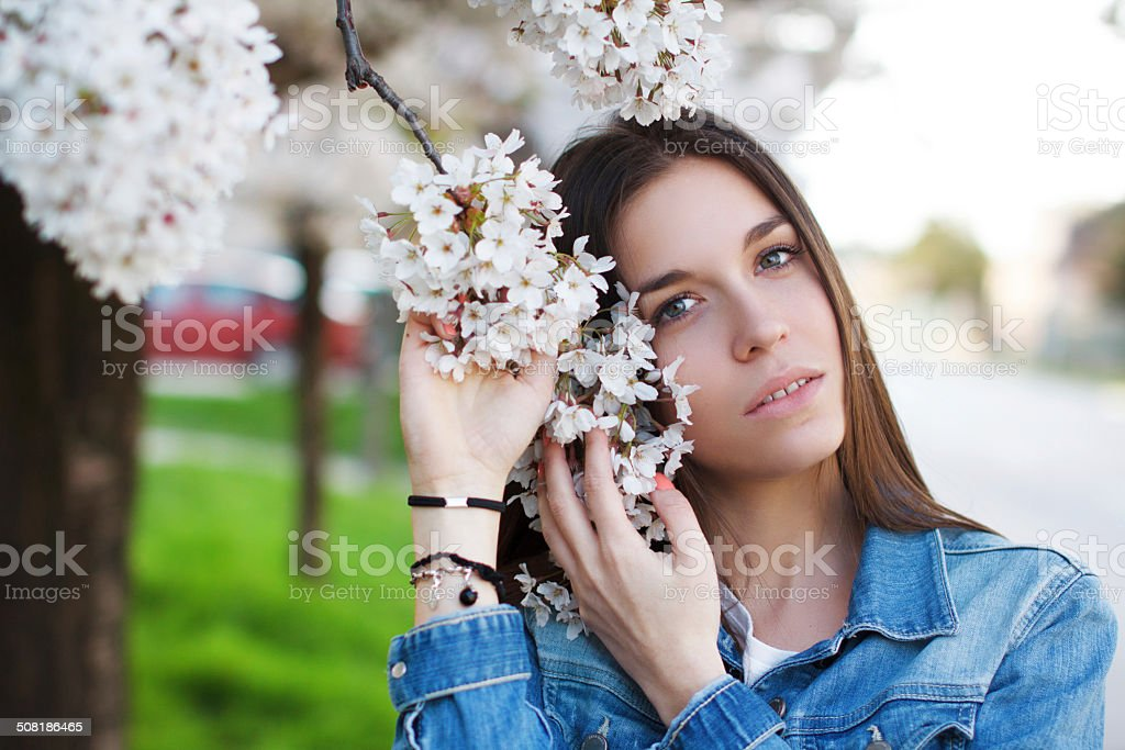 Woman posing with cherry tree flower royalty-free stock photo