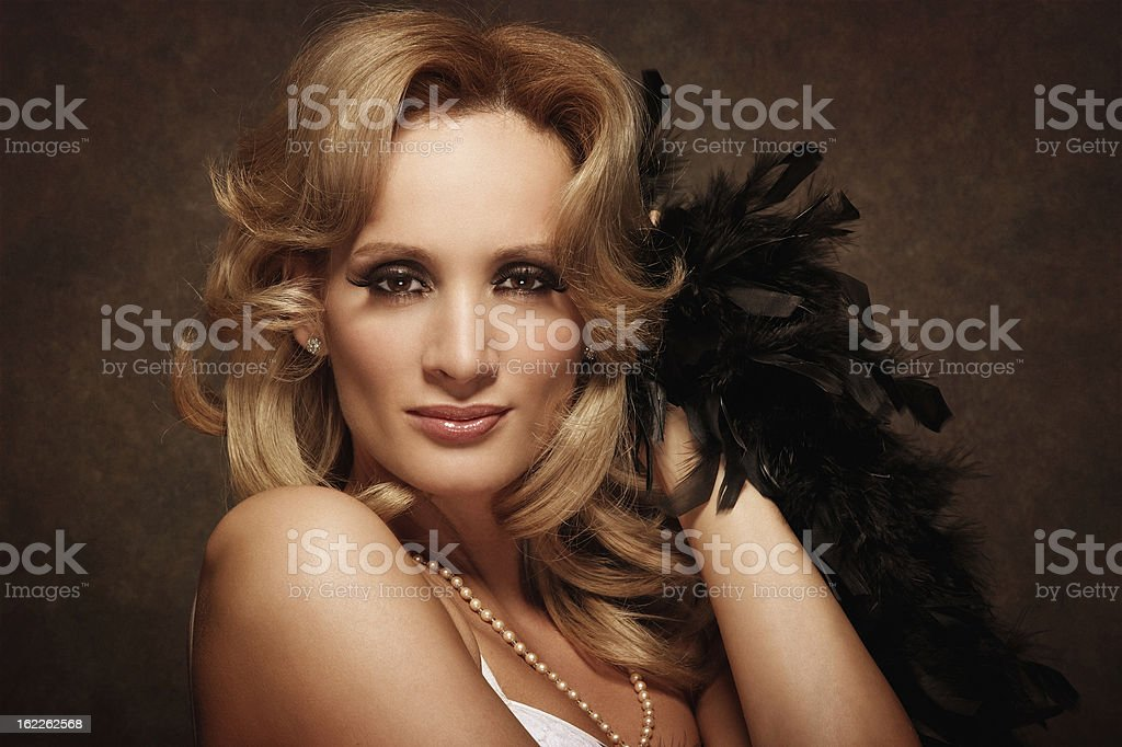 woman posing with feather boa - retro style royalty-free stock photo