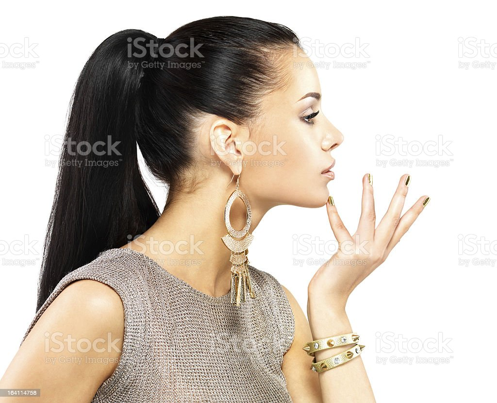 Woman posing with gold jewelry and nails royalty-free stock photo
