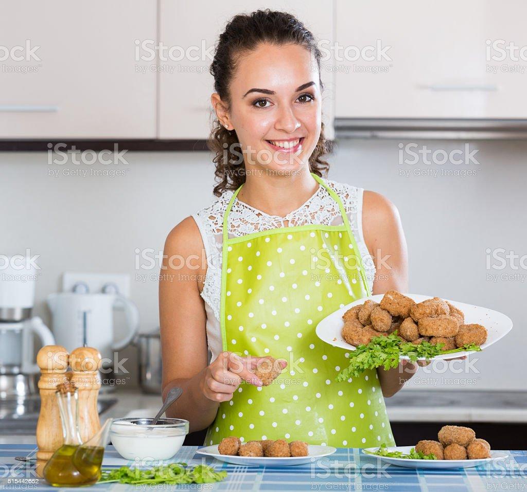 woman posing with plate of deep-fried kroketten stock photo