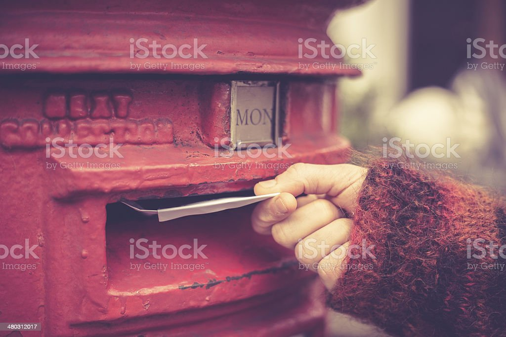 Woman posting letter stock photo