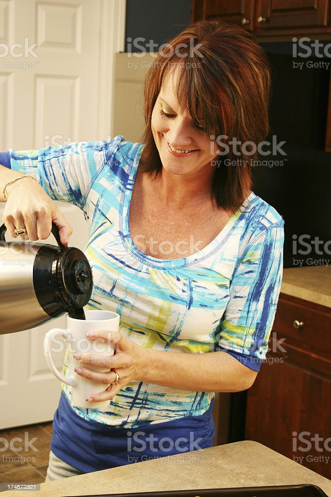 Woman Pouring A Cup Of Coffee royalty-free stock photo