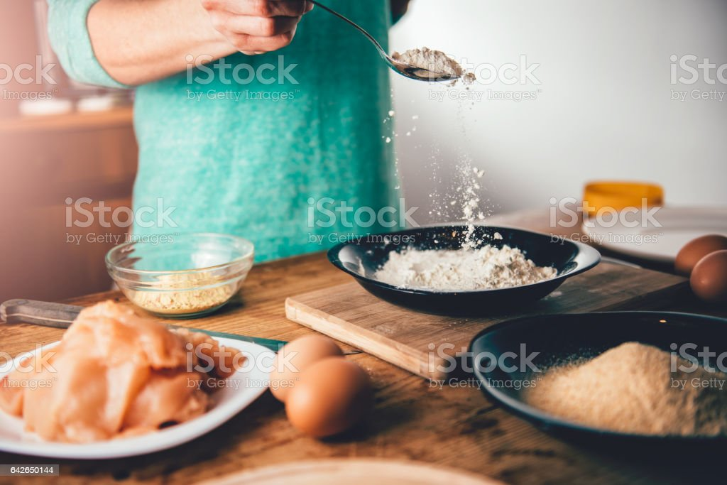 Woman Pouring breadcrumbs stock photo