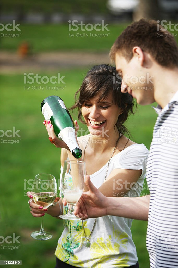 Woman pouring champagne royalty-free stock photo