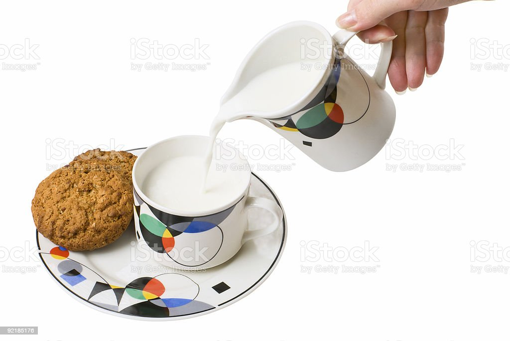 Woman, pouring milk to cup royalty-free stock photo