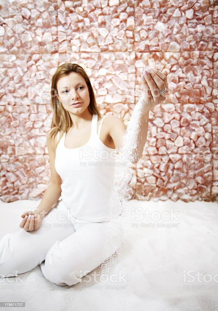 Woman pouring salt out of her hands. stock photo