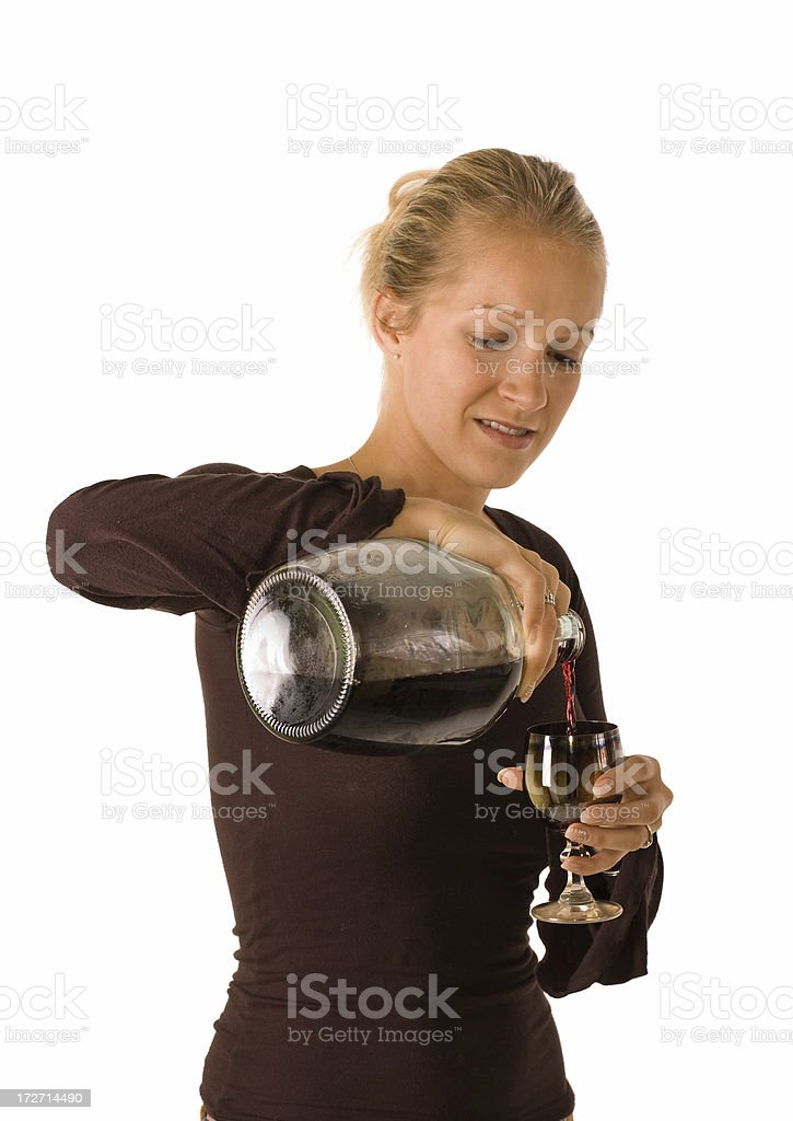 Woman pouring wine isolated on white royalty-free stock photo