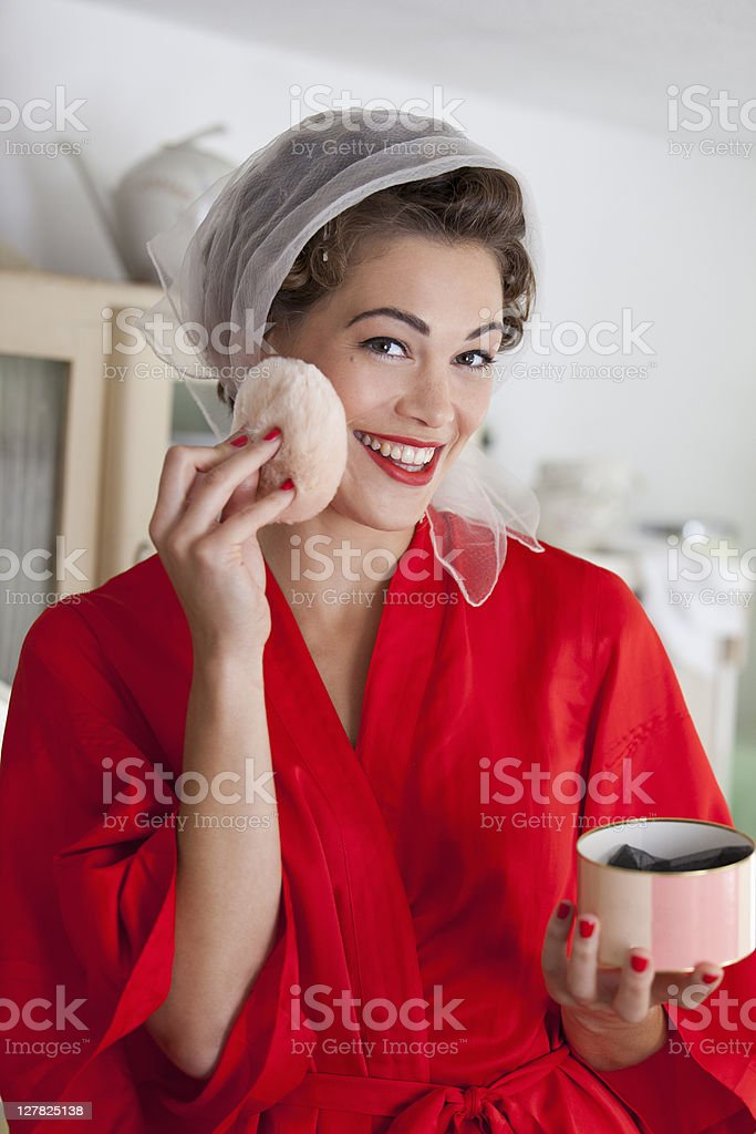 Woman powdering her face royalty-free stock photo
