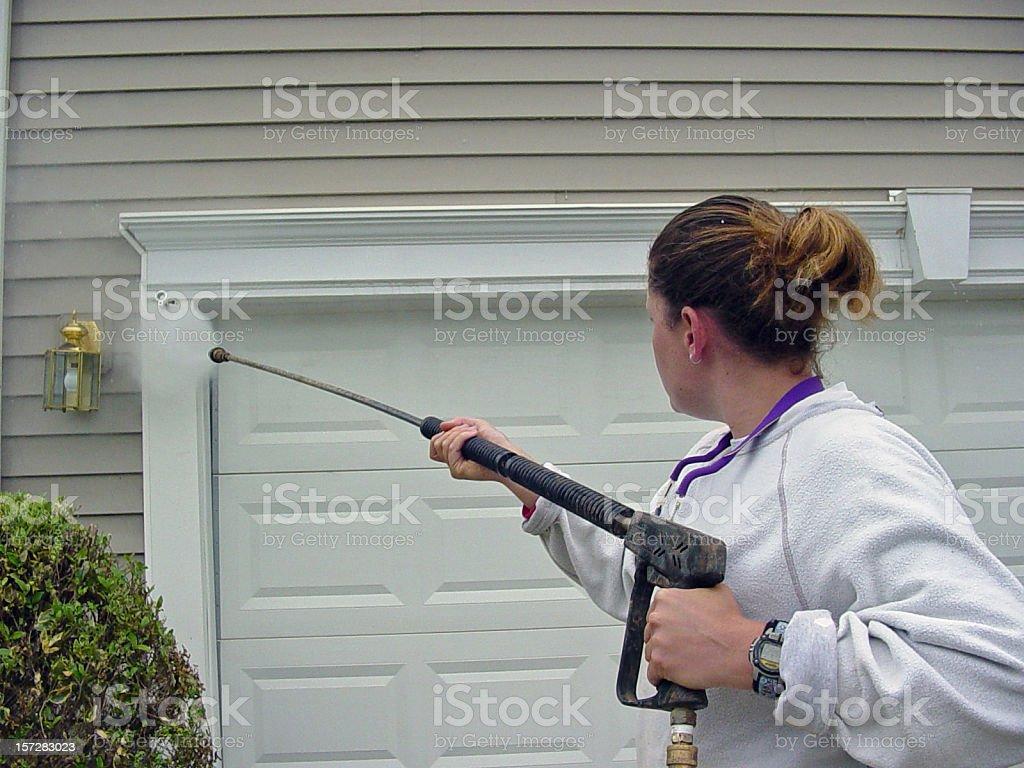 Woman Powerwashing 2 royalty-free stock photo