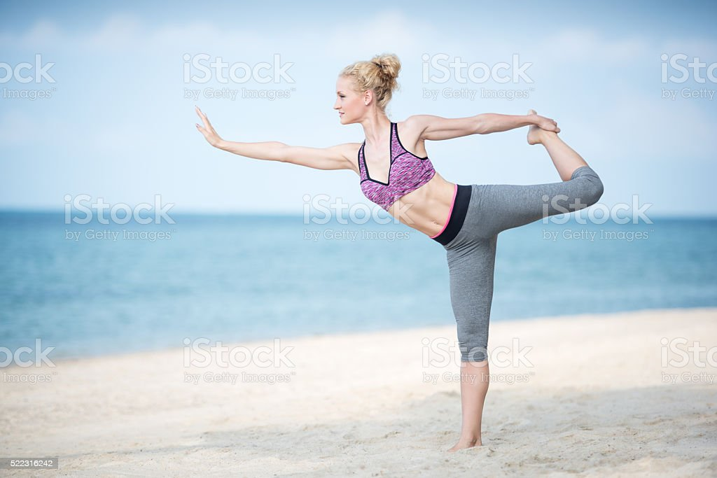 Woman praciticing a Yoga at the Beach stock photo