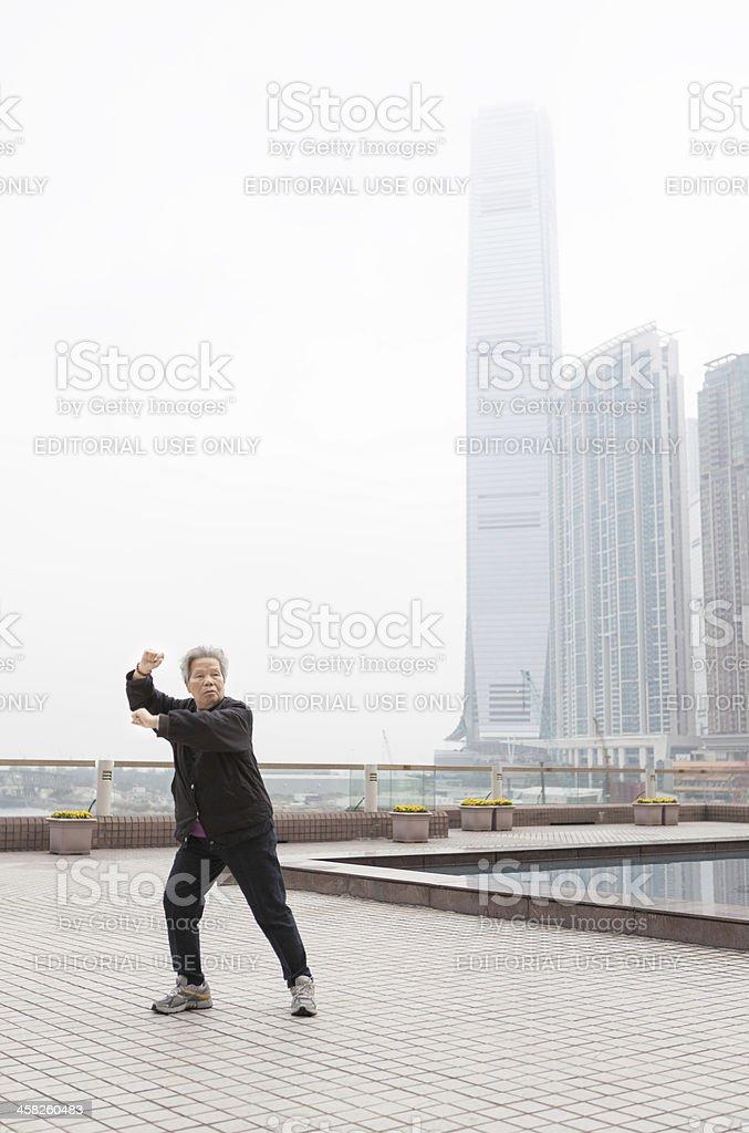 Woman practices Tai Chi in Hong Kong stock photo