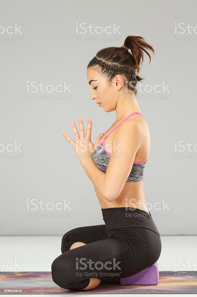 Woman practicing advanced yoga    Yoga block poses stock photo