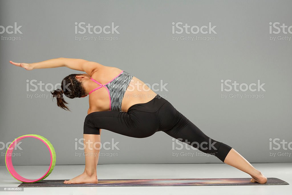 Woman practicing pilates  Fitness Stretching training stock photo