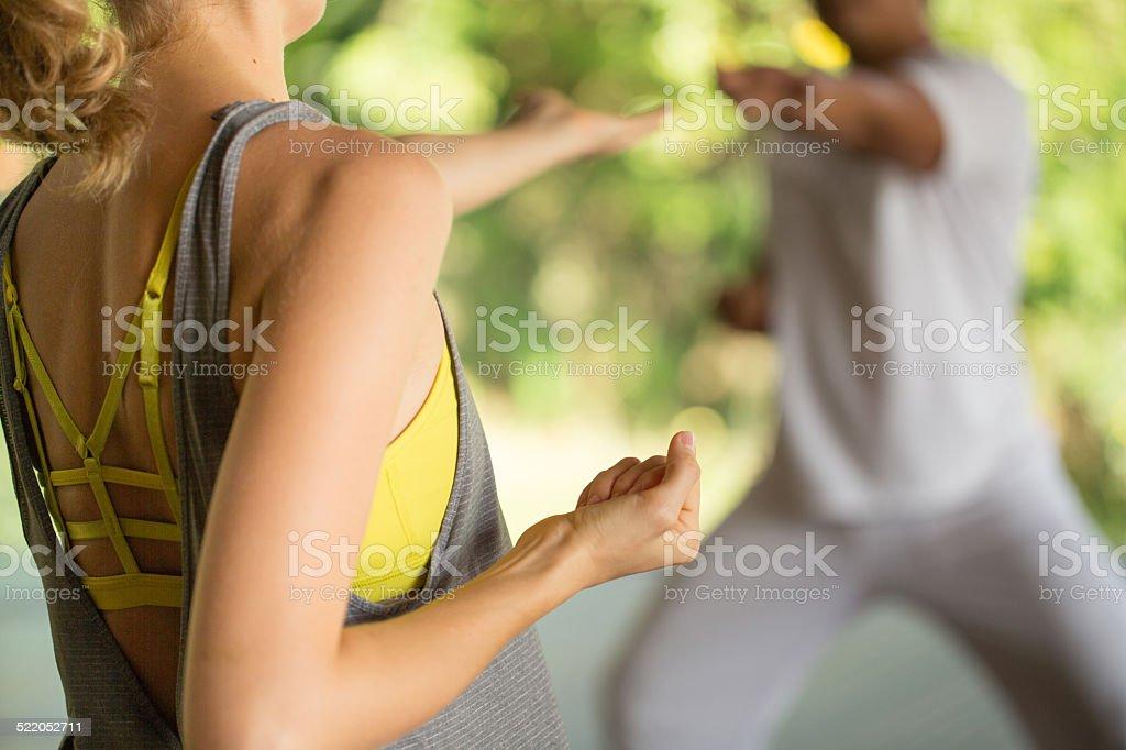 Woman practicing tai chi stock photo