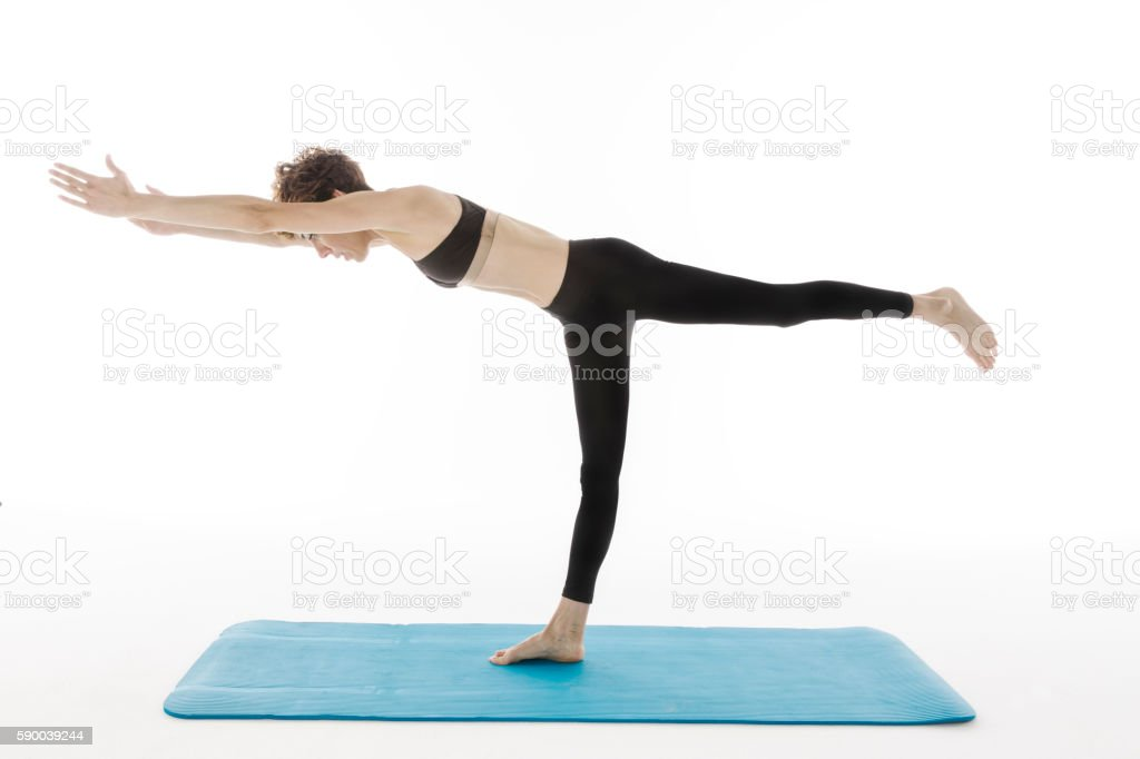 woman practicing various yoga poses stock photo