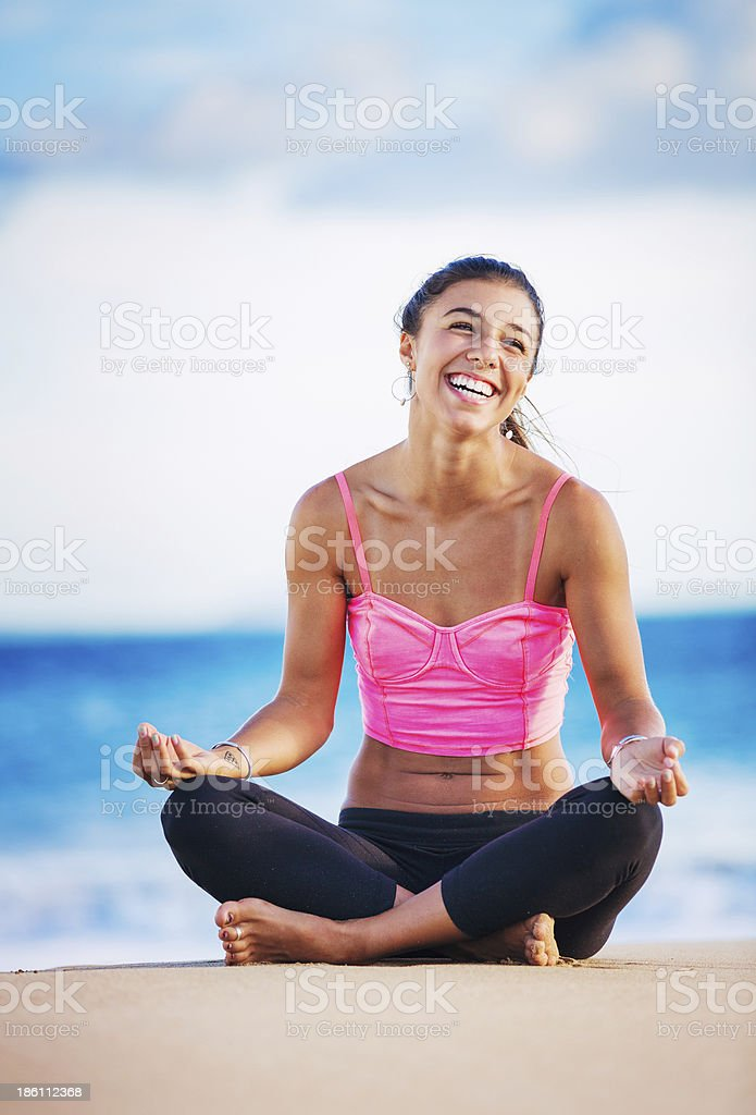 Woman practicing yoga at sunset royalty-free stock photo