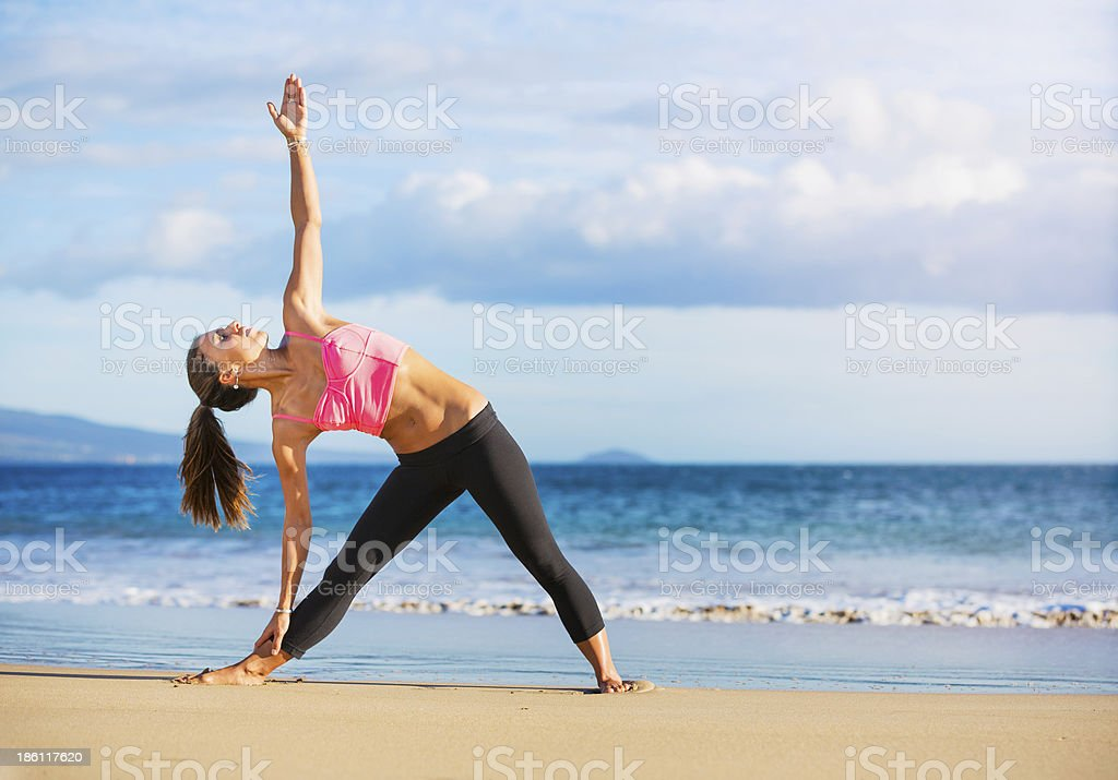 Woman practicing yoga at sunset royalty-free stock photo