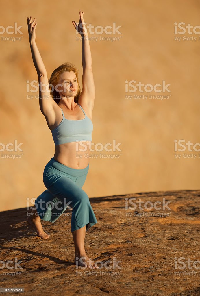 Woman Practicing Yoga  In Variation Of High Lunge Pose royalty-free stock photo