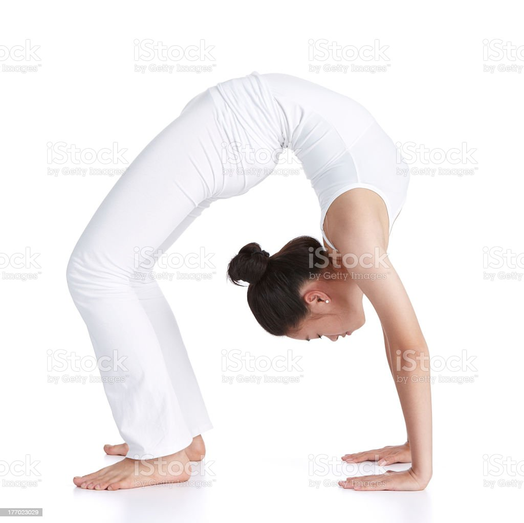 Woman practicing yoga in white clothes stock photo