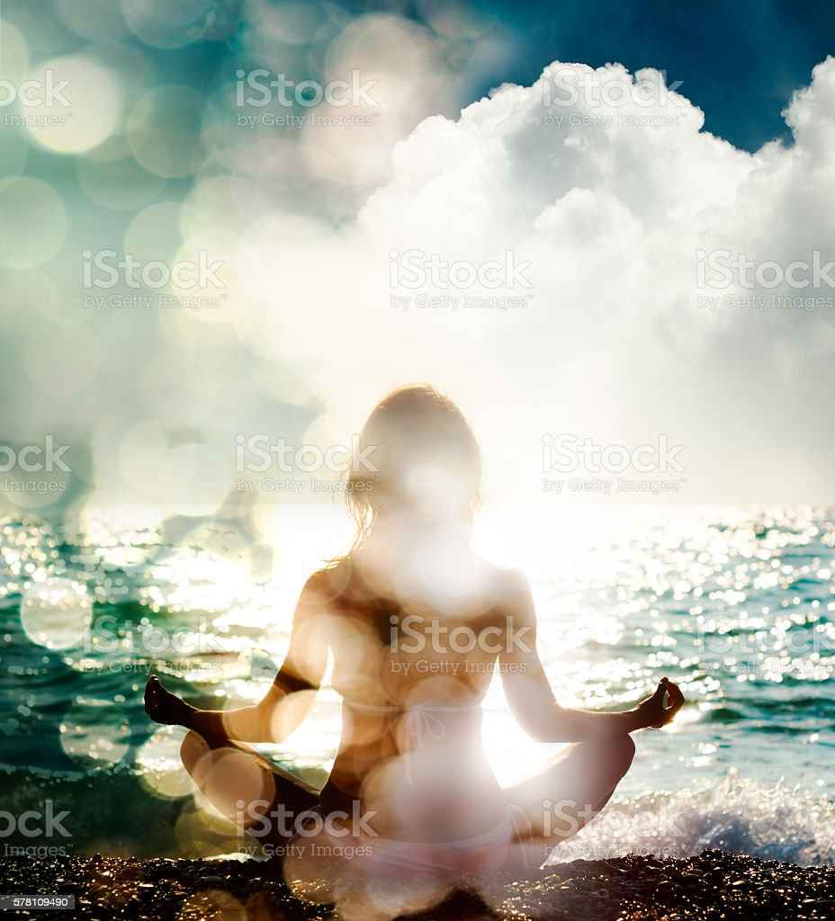 Woman Practicing Yoga on Nature Background stock photo