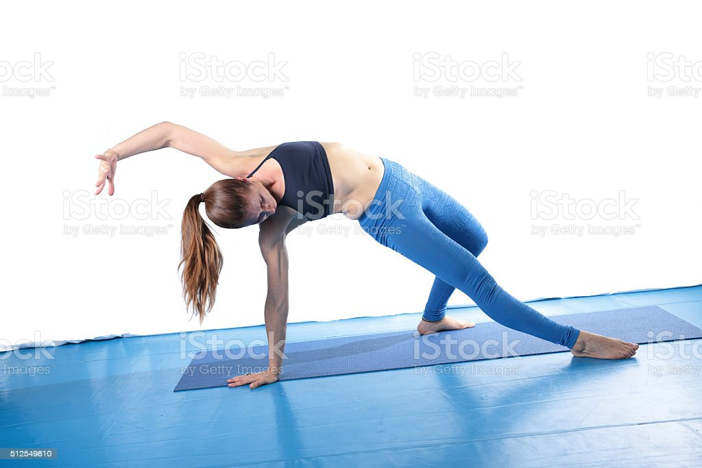 Woman practicing yoga on the floor stock photo