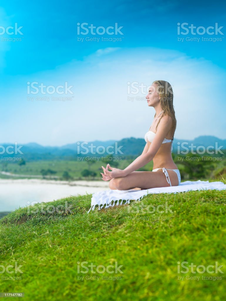 Woman practicing yoga on the hill royalty-free stock photo