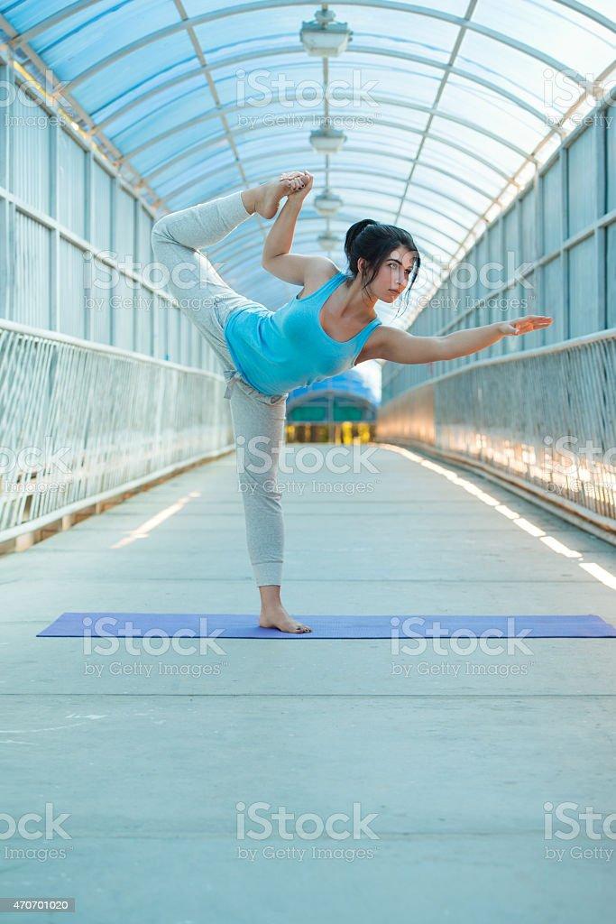 Woman Practicing Yoga Outside stock photo
