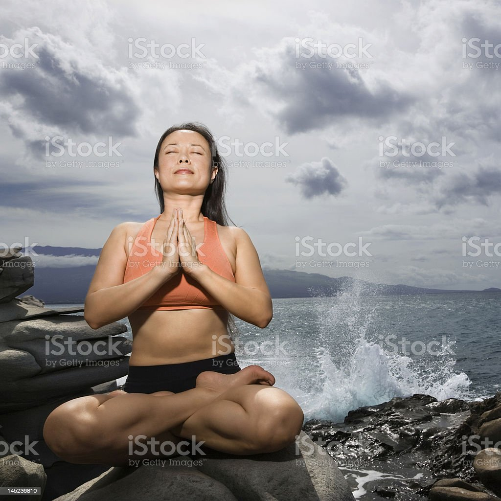 Woman practicing yoga royalty-free stock photo