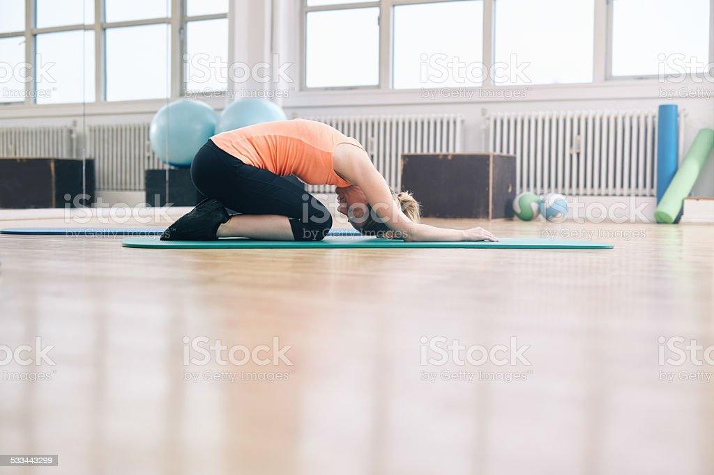 Woman practicing yoga stock photo