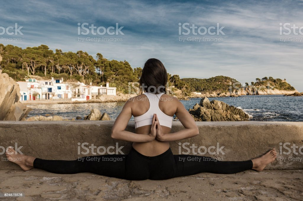 Woman practicing yoga pose with reverse namaste stock photo