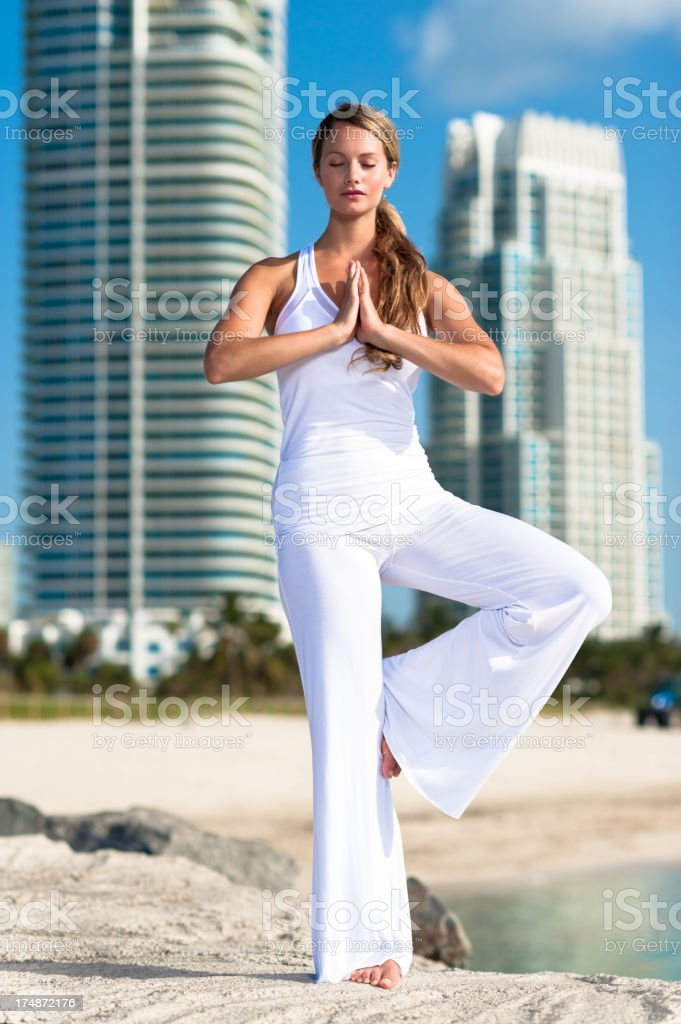 Woman Practicing Yoga Tree Pose royalty-free stock photo