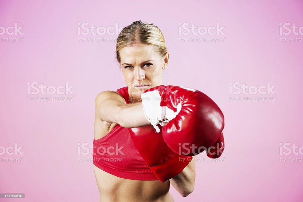 Woman practicinig boxing royalty-free stock photo
