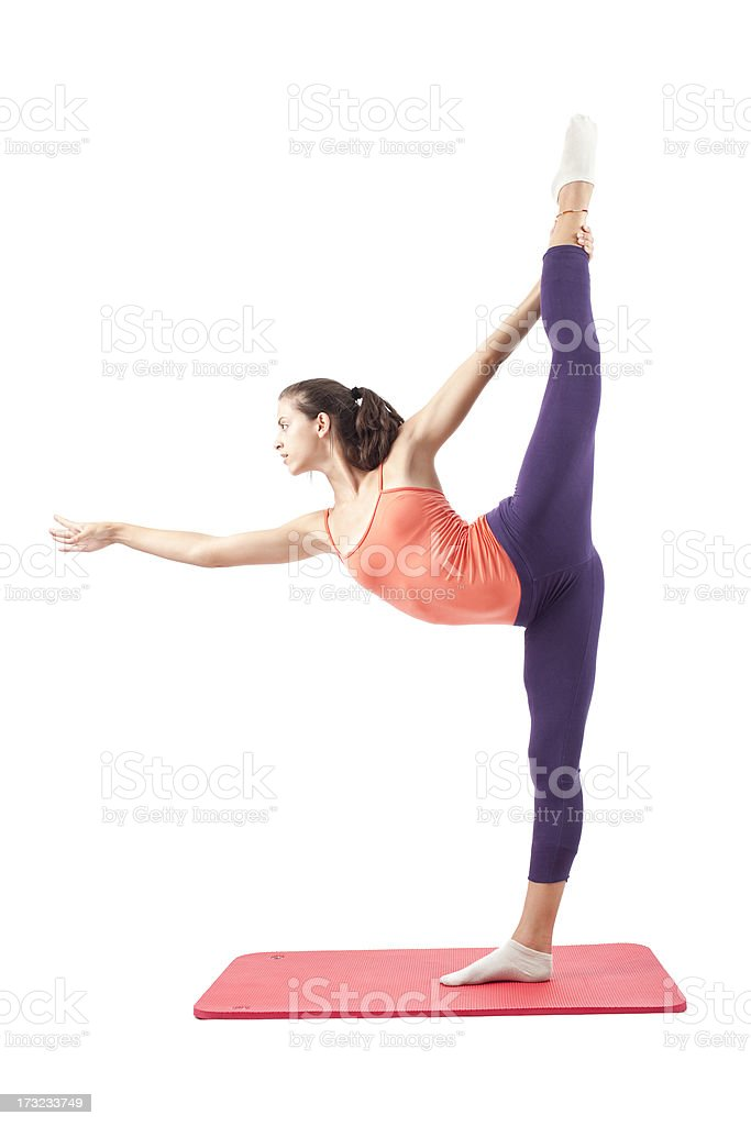 Woman practing yoga pose. royalty-free stock photo
