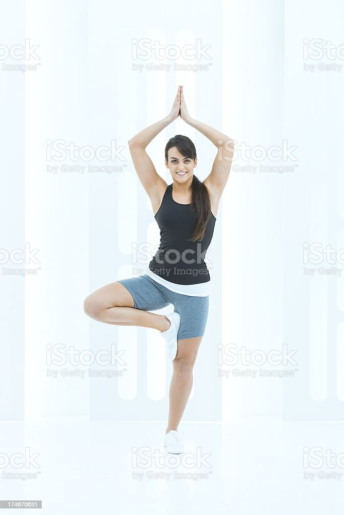 Woman practising yoga in a modern space royalty-free stock photo
