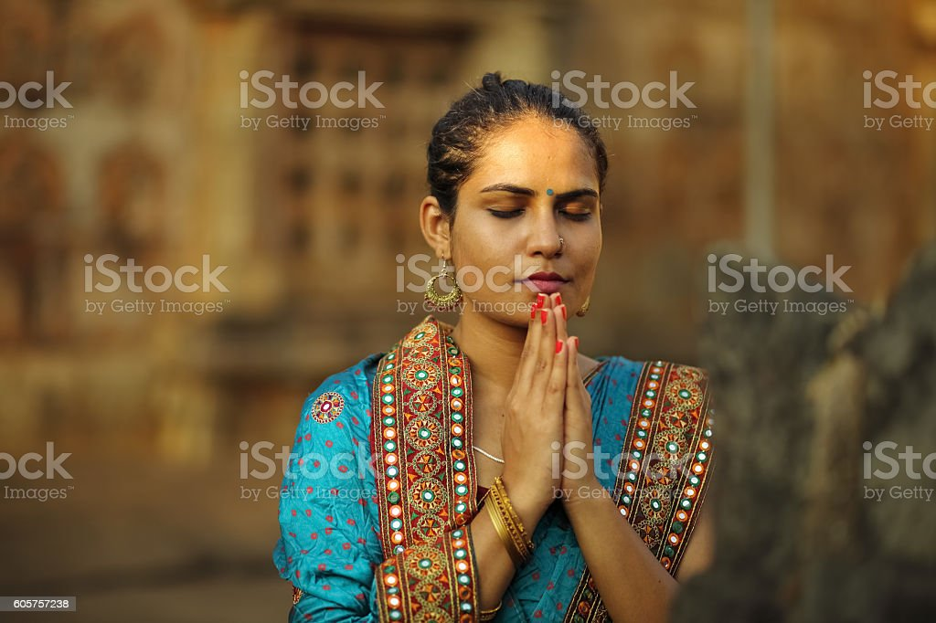 Woman Praying at Temple stock photo