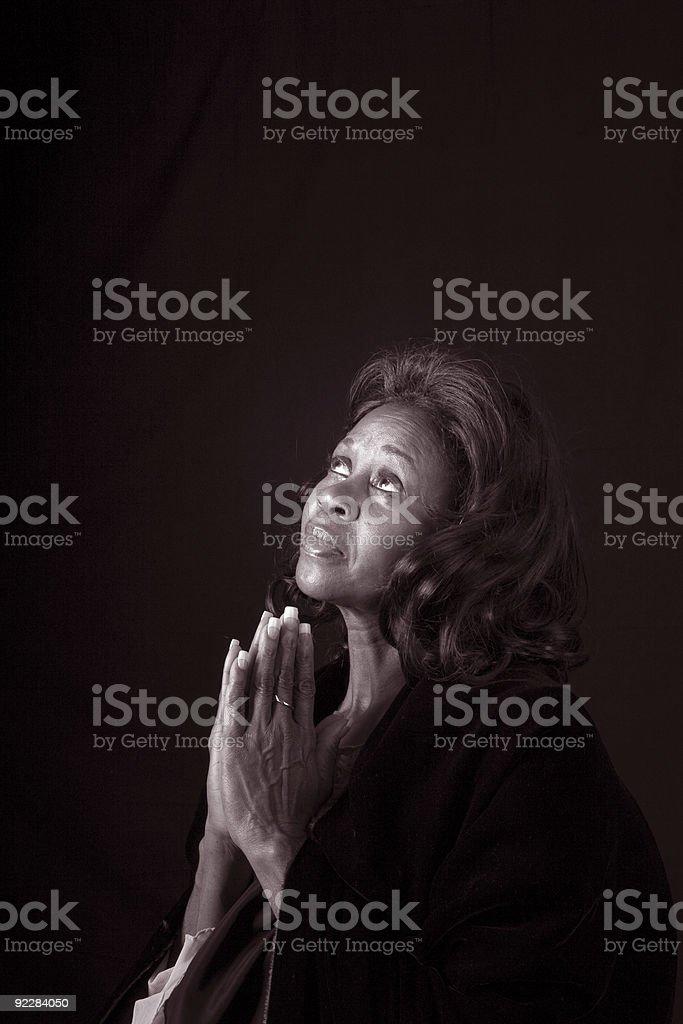 Woman Praying Black and White royalty-free stock photo