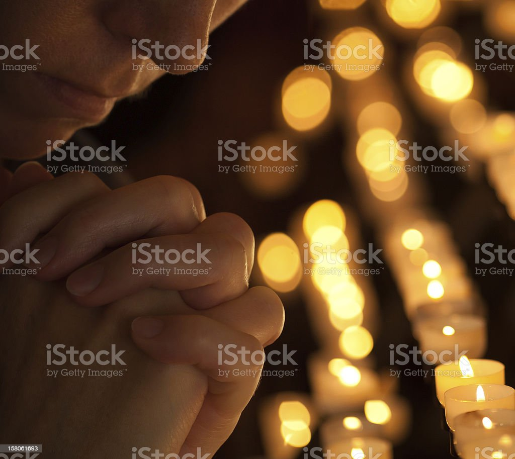 Woman praying in church cropped part of face stock photo