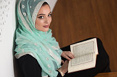 Woman Praying In The Mosque And Reading Quran